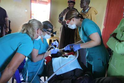Honey Orthodontics Kenya Mission - Oasis for Orphans - Performing Dental Work